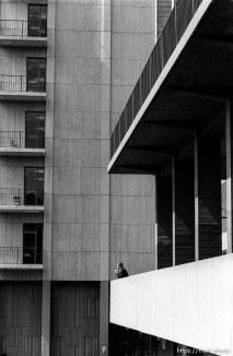 Man smoking and buildings.