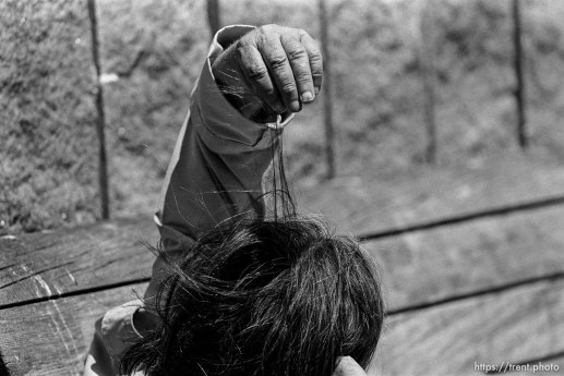 Homeless man pulling his hair