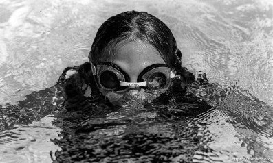 Girl with goggles swimming at the Las Trampas Pool.