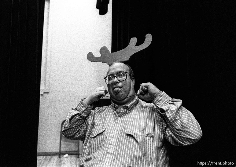 Man putting on antlers at Walnut Creek 2nd ward Christmas Party.