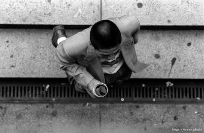Man walking below me with cup of coffee
