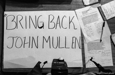 Signs and petition supporting John Mullen