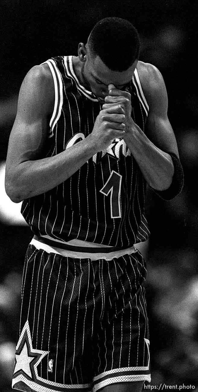 """Anfernee """"Penny"""" Hardaway with head in hands at Warriors vs. Orlando Magic basketball."""