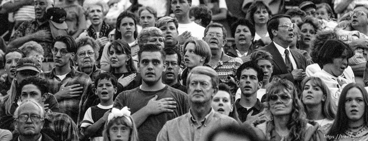 People during national anthem at the Stadium of Fire