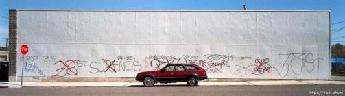 Gang graffiti on building