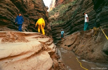 People walking on newly created sand beaches. Grand Canyon flood trip.