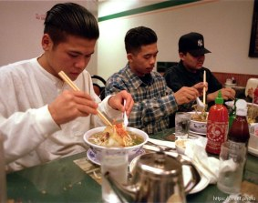 Oriental Posse members, noodles and rice at Cafe Kim.