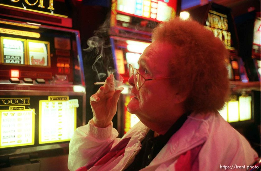 Woman gambling and smoking on wendover trip with nursing home