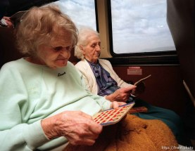 Old ladies playing BINGO on fun bus to Wendover.