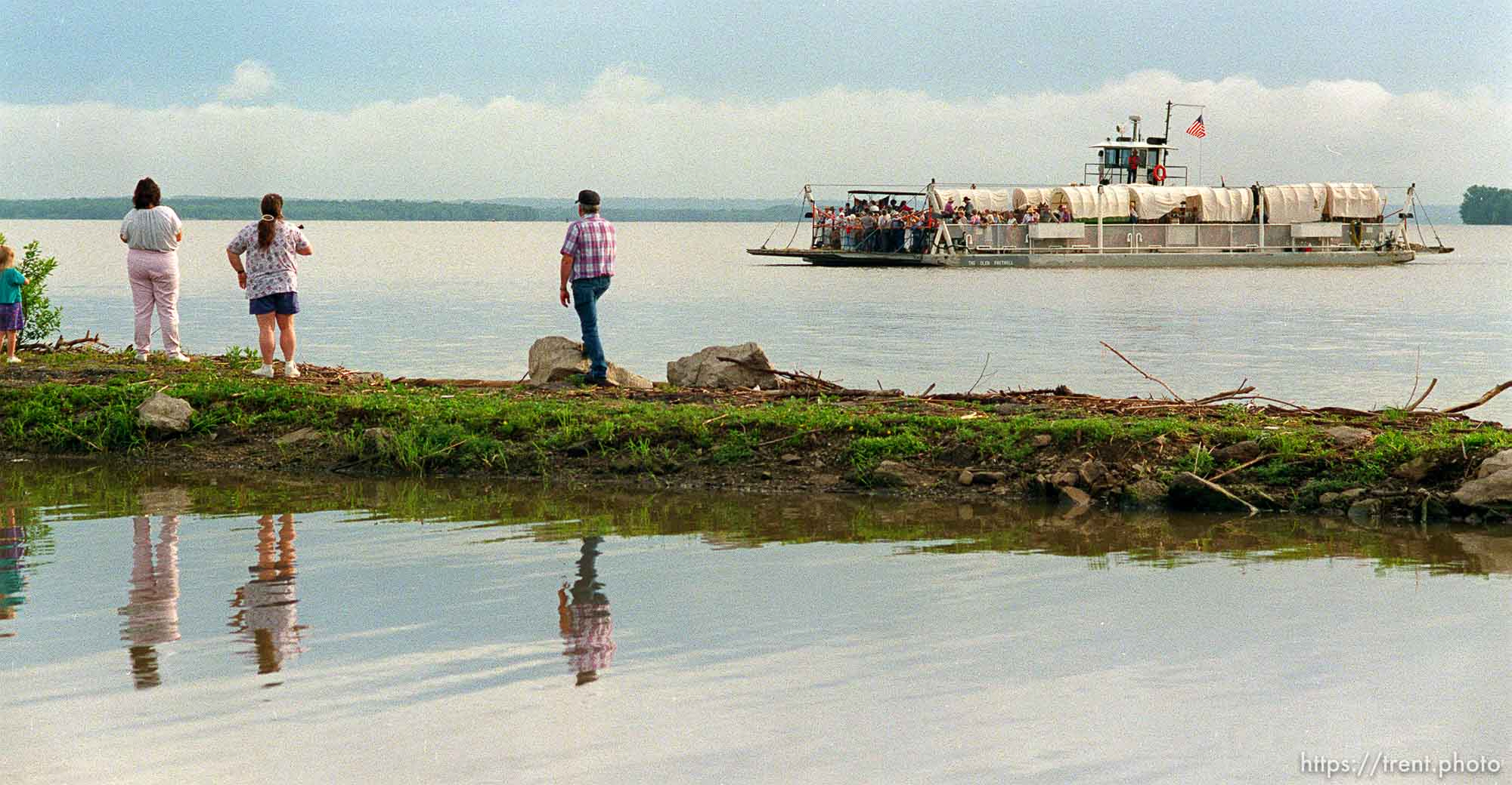 Ferry carries wagons across Mississippi River at Mormon Wagon Trail re-enactment