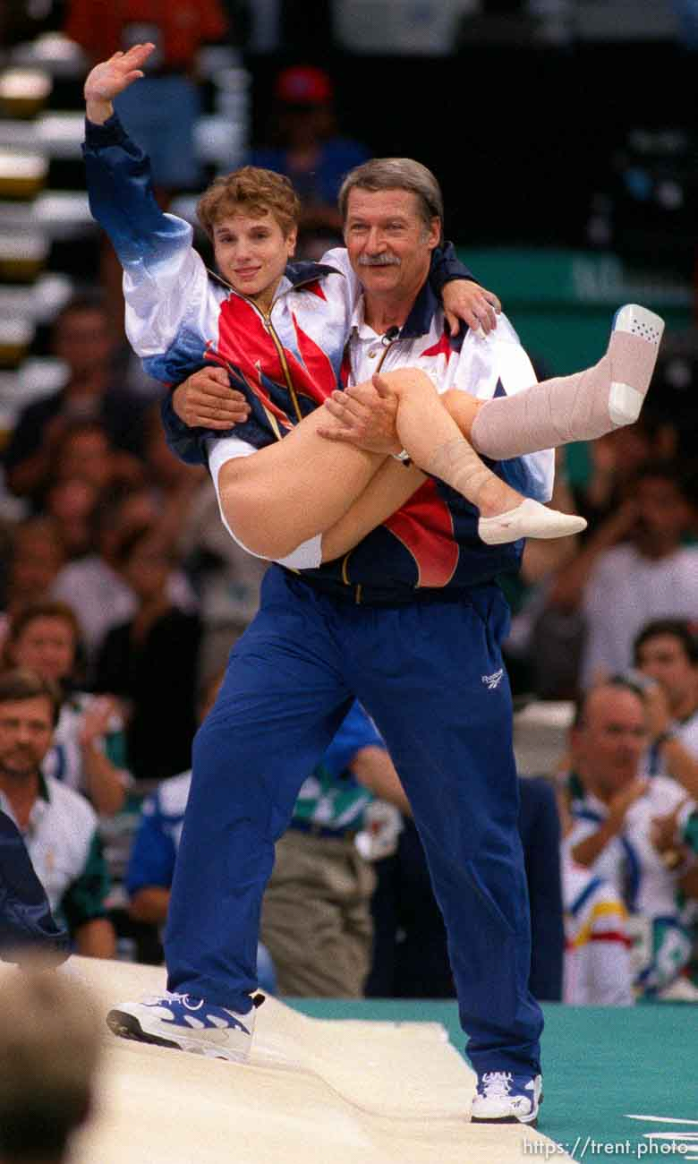Coach Bela Karoly carries an injured Kerri Strug at Womens Team Gymnastics at the 1996 Summer Olympic Games