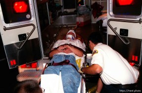 A straightedge punk is loaded into ambulance after riot broke out at a hardcore show in Salt Lake City, Utah. The New York band Madball had yet to take the stage. Police were called after a fight broke out in the club (Spanky's). When they arrived, they cleared the club using tear gas. In the mid 90's after numerous violent incidents, the Salt Lake City Police Department formally declared straightedge a violent gang. October 10, 1996. photo copyright - Trent Nelson. http://www.trenthead.com