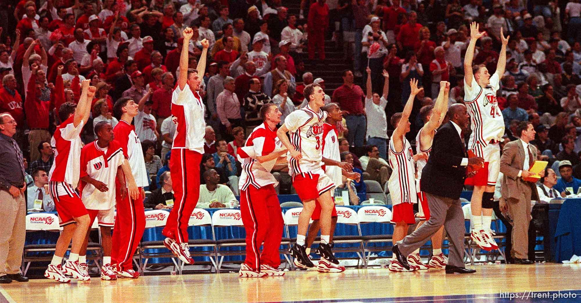 Team celebrates win at Utah vs Stanford, NCAA Tournament.