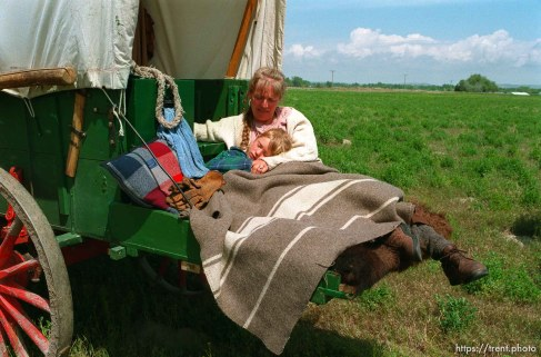 Sarah Dicken, with a 102 degree fever, in her mother Shauna's arms as the Mormon Trail Wagon Train stops for lunch.