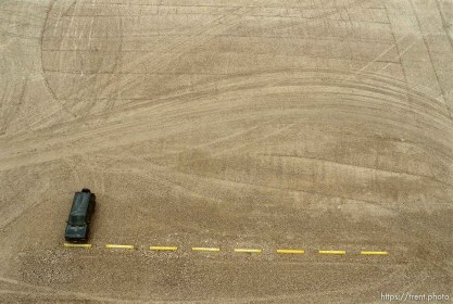 Car in empty lot from the top of a grain elevator at Jack's Bean Company.