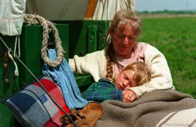 Sarah Dicken in the arms of her mother Shauna on the Mormon Trail Wagon Train. Sarah has a fever of 102°. They are from Washington state, and have no support vehicles. Just the wagon.