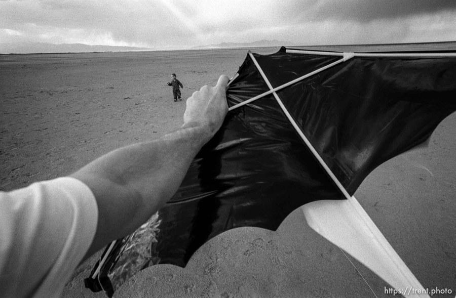 at the Salt Lake flying a kite.