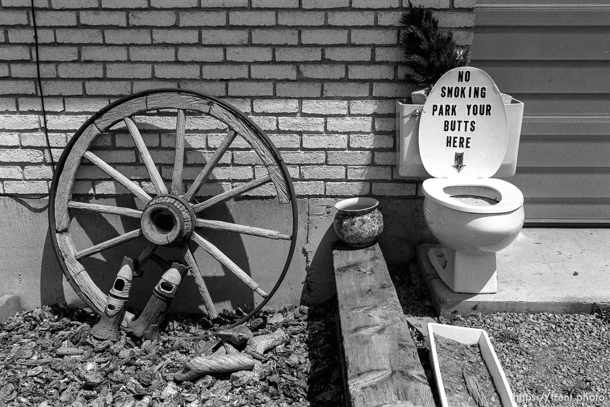"""""""No smoking park your butts here"""" sign on toilet."""