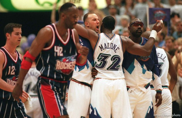 Utah's Greg Foster and Karl Malone embrace as Rockets' Matt Maloney (12) and Kevin Willis (42) walk off court near the end of Utah Jazz vs. Houston Rockets, game 5 of the 1st round, NBA Playoffs. Jazz won.
