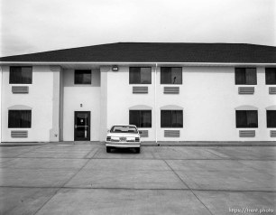 Motel parking lot and building.