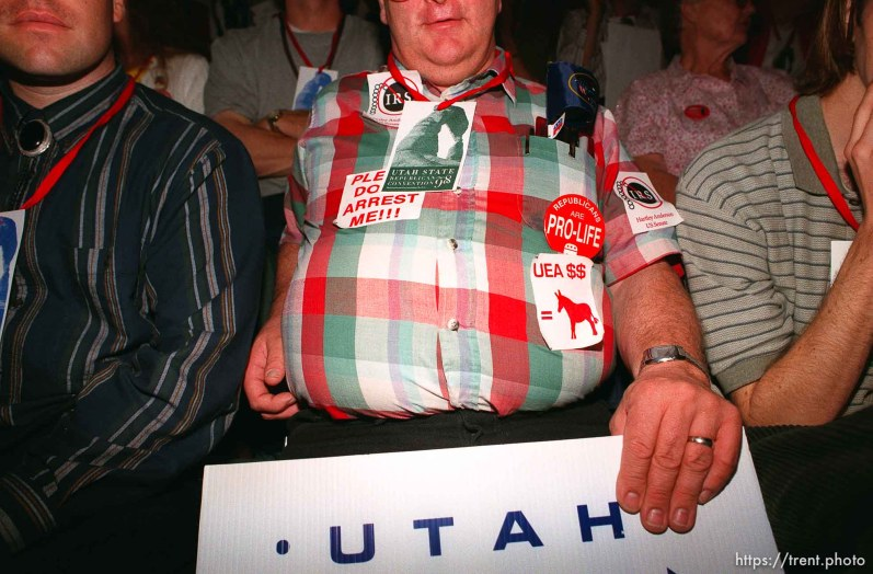 Delegate with stickers and signs at the Utah State Republican Party Convention, held at Utah Valley State College.