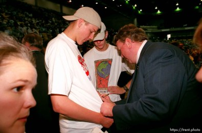 Congressman Merrill Cook signs Trent Lloyd's t-shirt at the Utah State Republican Party Convention, held at Utah Valley State College.