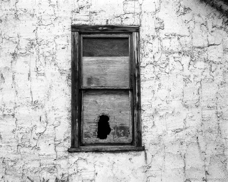 Boarded-up window on house at Aunt Bea's farm.