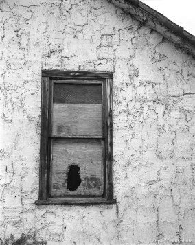 Boarded-up window of house at Aunt Bea's farm.
