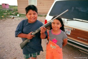 Percy Jenks with a BB gun and his sister Jessy Jenks.
