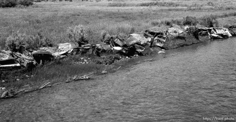 Abandoned cars set along the banks of the Duchesne River.