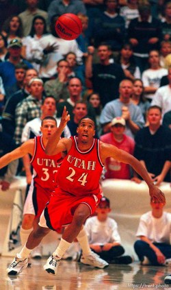 Andre Miller chases a loose ball at Utah vs. Utah State.