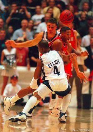 Andre Miller loses the ball as he's fouled by Rashad Elliott at Utah vs. Utah State.