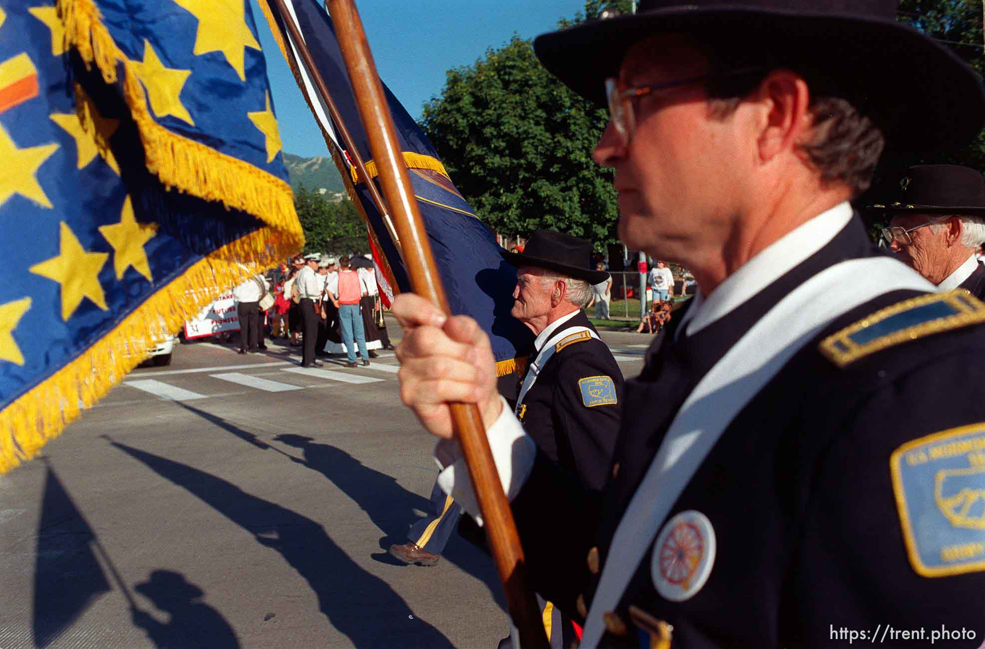 Jay Bowen (center) carries the Utah State flag with the United States Mormon Battalion in the Bountiful Hand-Cart Festival Parade