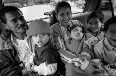 In a taxi, Jose, Doris, Doris, Bessy, Eduardo, Hexi. Formerly conjoined twins, Bessy and Doris Gonzales.