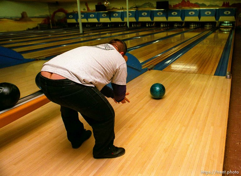 Disabled kids bowling and playing videogames. Guy bending over