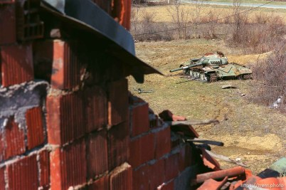 Ruins of a home and a Yugo tank.