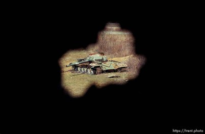 Destroyed Yugo tank, seen through a shell hole.