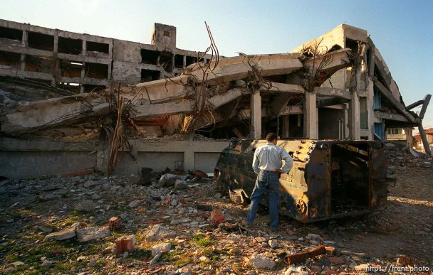 Ed Knowles urinates on a Serb police APC in front of the destroyed Serbian MUP police station.