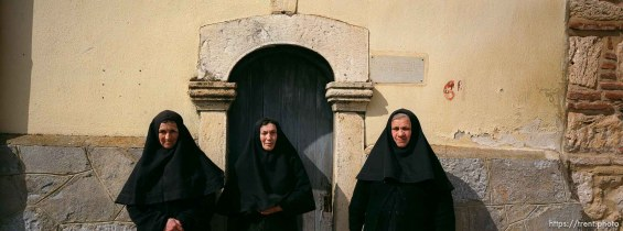 Three Serbian nuns in front of their 14th century church.