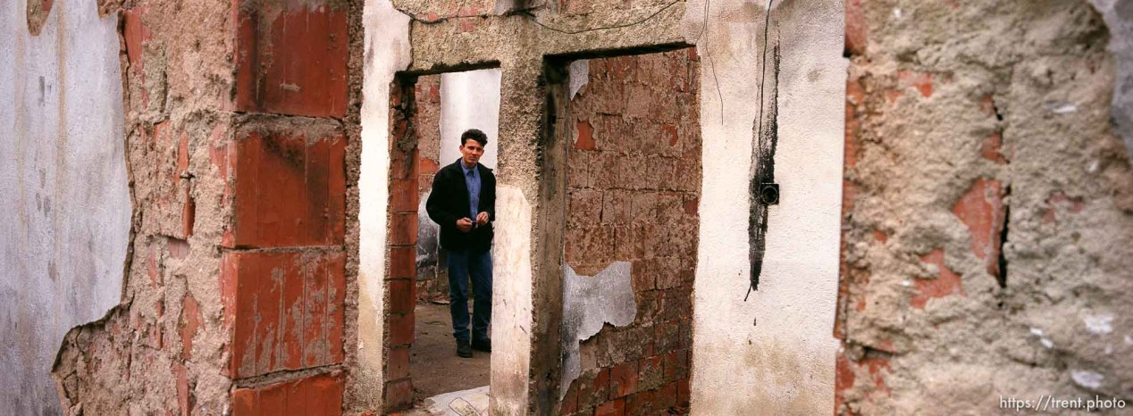 Anton Selitaj in what's left of his room in the family home, which was burned by Serbs.