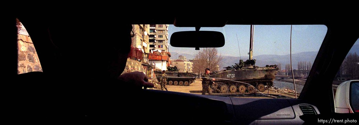 UNMIK police officer Zane Smith driving through a KFOR checkpoint in north Mitrovica.