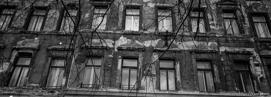 Beat-up, possibly shot-up building.