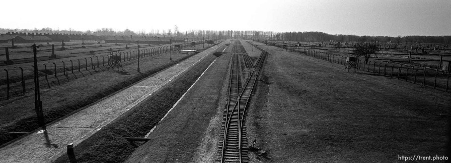 """View of the rails and camp from the """"Death Gate"""" guard tower at the Birkenau Concentration Camp."""