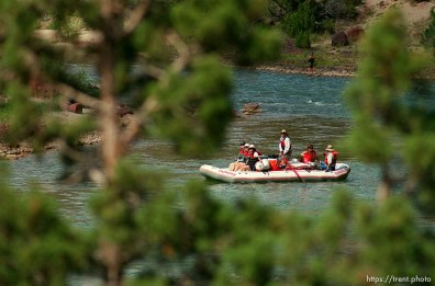 Dee Holladay pilots his boat on a Native American river trip through Lodore Canyon and Dinosaur National Monument.