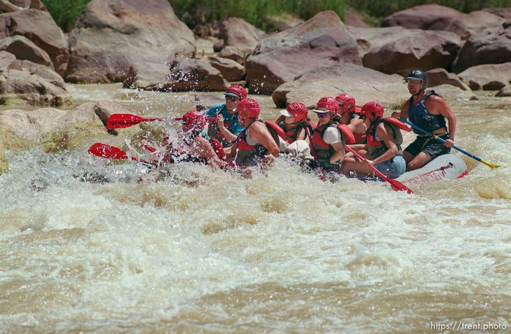 A paddle-boat, piloted by David Vernon (far right) goes through Hells Half Mile on a Native American river trip through Lodore Canyon and Dinosaur National Monument.