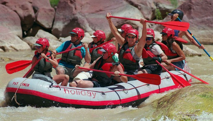 After the paddle boat made it throug Hells Half Mile, Don Girskis raises his oar, on a Native American river trip through Lodore Canyon and Dinosaur National Monument.