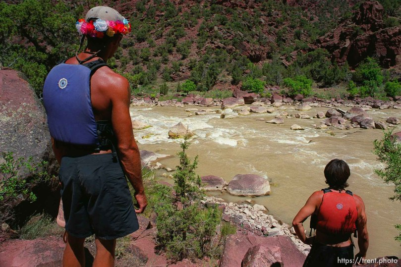 River guides Nick Berich and Thomas Hayden scout the rapid Hells Half Mile on a Native American river trip through Lodore Canyon and Dinosaur National Monument.