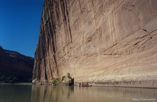 A raft next to Steamboat Rock on a Native American river trip through Lodore Canyon and Dinosaur National Monument.