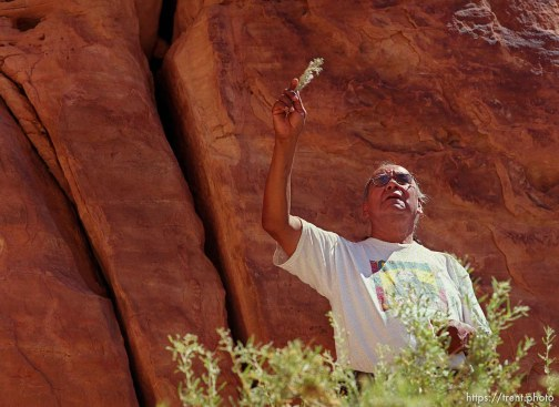 Clifford Duncan performs a ceremony at the sight of ancient petroglyphs at Echo Park on a Native American river trip through Lodore Canyon and Dinosaur National Monument. He is waving sage.