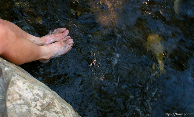 Jill Bohney puts her feet in a stream at the end of the race, Sundance Ski Resort. Wasatch 100 Endurance Run.